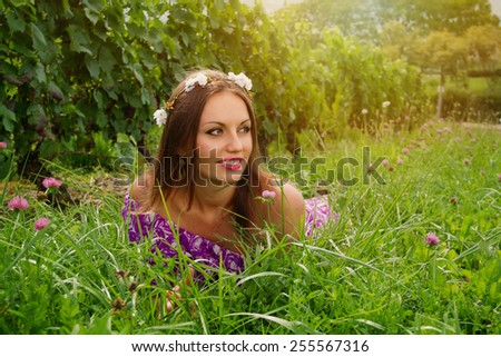 The young woman in the vine yard - stock photo