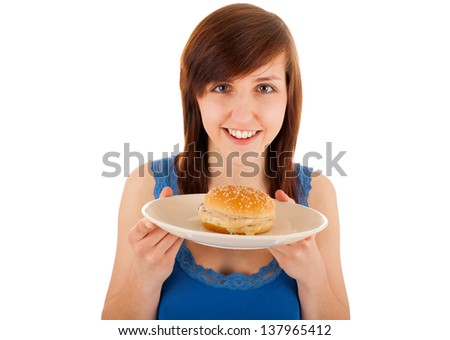 The young woman is eating a cheeseburger