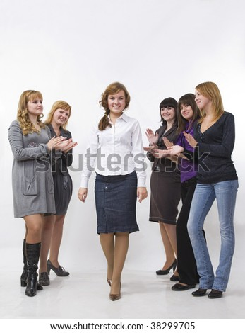 The young woman passes by group of women which clap - stock photo