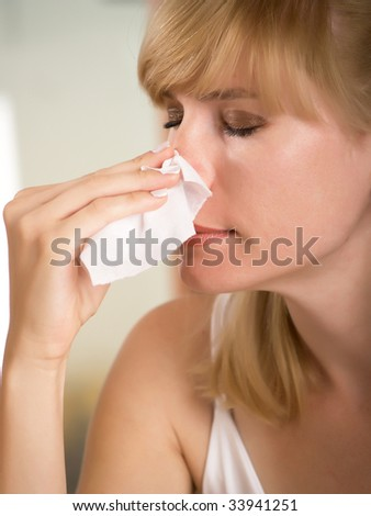 The young woman wipes a napkin the nose - stock photo