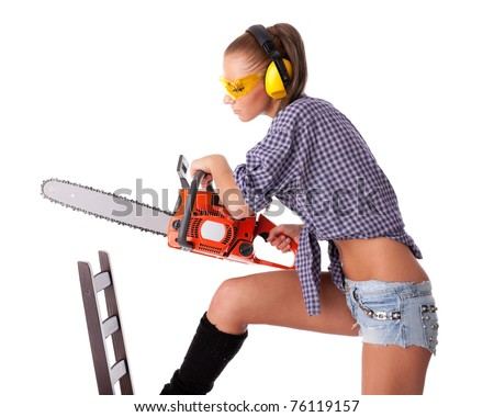 The young woman with a chainsaw on a white background. - stock photo