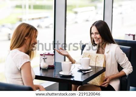 The young women with shopping bag in the cafe - stock photo