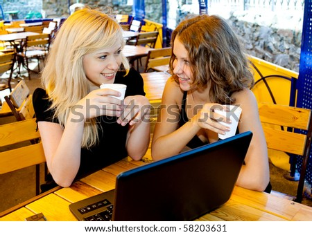 The youth group has a rest in cafe - stock photo