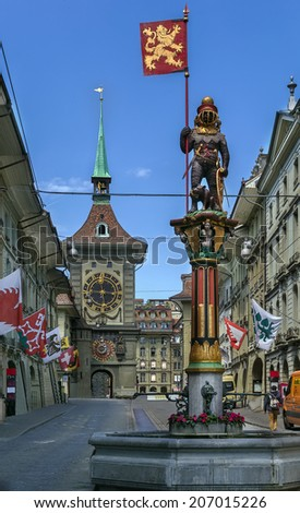 The Zytglogge clock tower and the city's medieval covered shopping promenades - stock photo