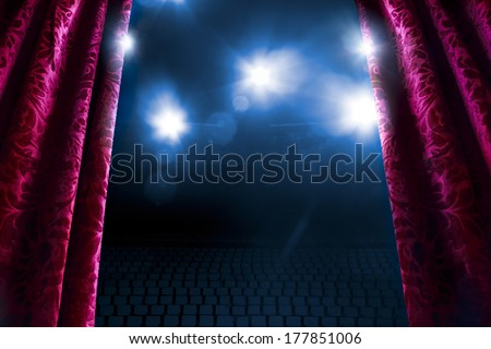 Theater curtain with dramatic lighting and lens flare - stock photo