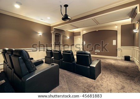 Theater in luxury home with stadium seating - stock photo