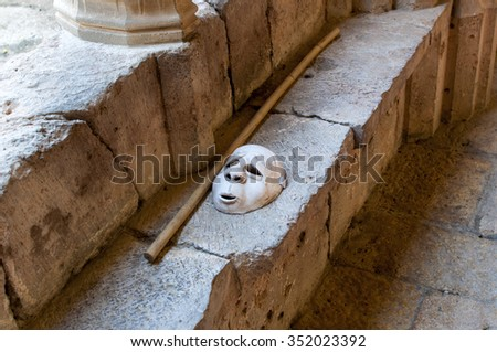 Theater mask over stone - stock photo