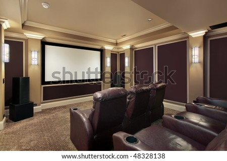 Theater room in luxury home with lounge chairs - stock photo