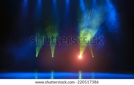 Theater stage with curtains and spotlights. Theatrical scene in the light of searchlights, the interior of the old theater. Light stage spotlights. - stock photo