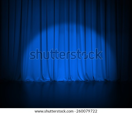 theatre dark blue curtain or drapes with light spot - stock photo