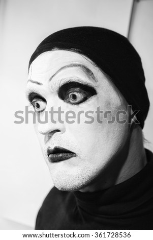 Theatrical actor with dark makeup on her face close up - stock photo