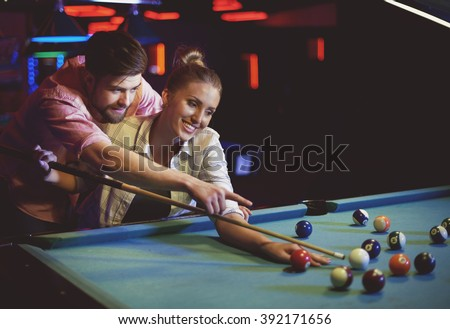Their first date in pool game club - stock photo