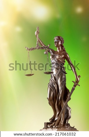 Themis in spotlight - concept of justice - stock photo