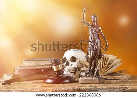 Themis in spotlight - concept of justice. - stock photo