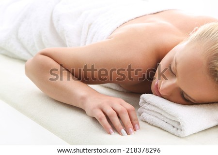 Therapeutic massage, heals the pain and relaxes . Attractive blonde woman in the office spa, relaxes August waiting for a cosmetic procedure.  - stock photo