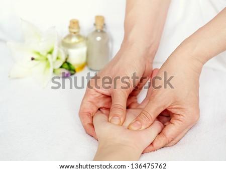 Therapist doing acupressure hand massage - stock photo