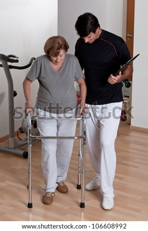 Therapist Helping Patient use Walker. - stock photo