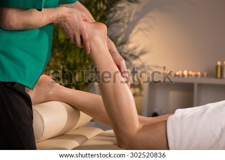 Therapy that includes reflexological techniques of massage - stock photo