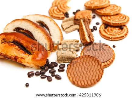 There are Cookies,Candy,Chocolate Peas,Poppy;Porcelain Saucer and Cap with Coffee,Tasty Sweet Food on the Wooden Background,Top View - stock photo