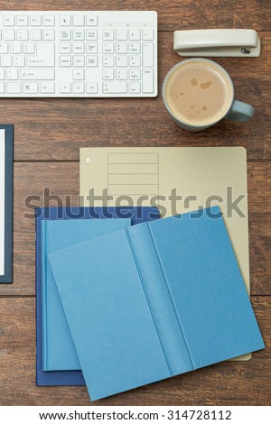 There are lots of notebooks on the office desk