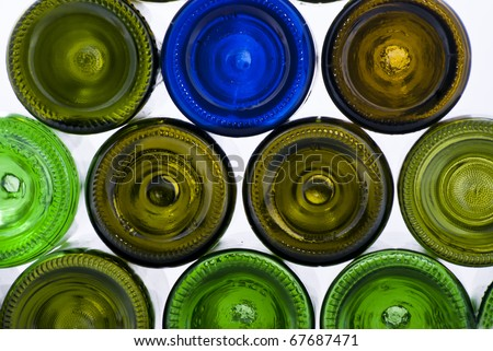 there are many varicoloured bottles on a white background - stock photo