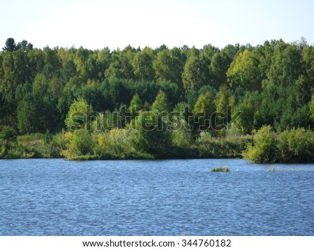 There are  river, sky and green  trees - stock photo