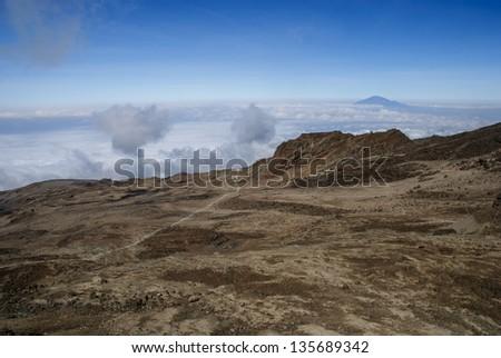 There are several routes by which to reach Kibo, or Uhuru Peak, the highest summit of Mount Kilimanjaro, namely, Marangu, Rongai, Lemosho, Shira, Umbwe and Machame. - stock photo