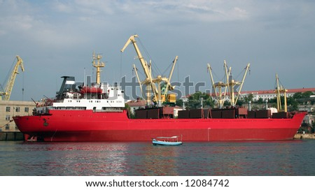 There is a red tanker in Sevastopol harbor, Ukraine.