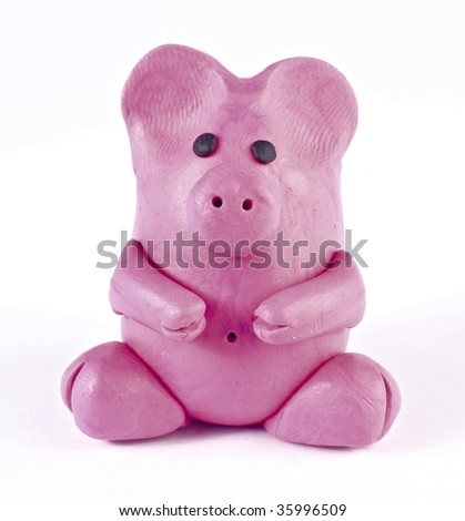 There is plasticine piglet isolated over white - stock photo