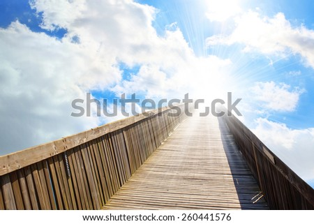 There is the light sky in the end of the bridge - stock photo