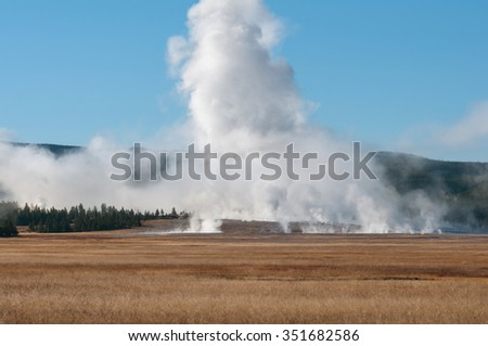 Thermal features in a meadow at Yellowstone National Park Wyoming. - stock photo