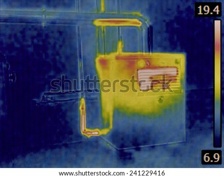 Thermal Image of a Heat Insulation of the Central Heating Furnace Tubes - stock photo