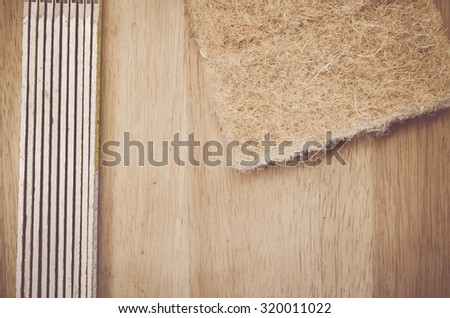 thermal insulating compressed hemp fiber panel and yardstick - natural wood background