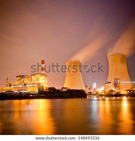 Thermal power plant at dusk - stock photo