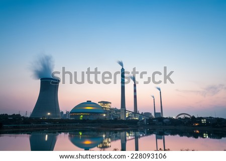 thermal power plant at dusk , industrial landscape  - stock photo