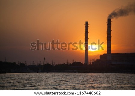 Thermal power stations and power lines during sunset