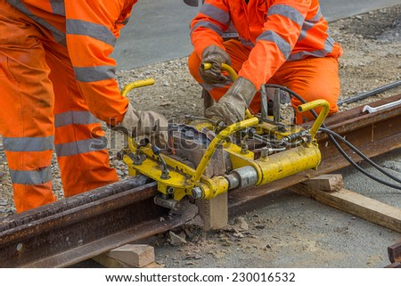 Thermit Welding Equipment. Weld Trimmer for removal of extra metal from rail head. Hydraulic trimming device. - stock photo
