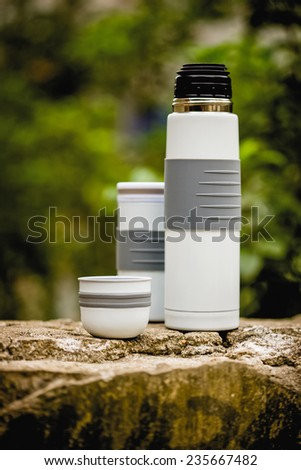 Thermo flask in outdoor with decoration, Aluminum mug - stock photo