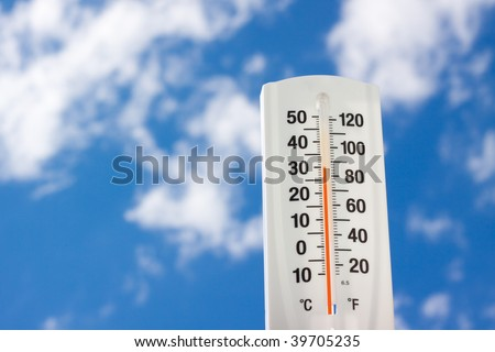 Thermometer against bluesky - stock photo