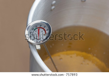Thermometer in a pot of oil - stock photo
