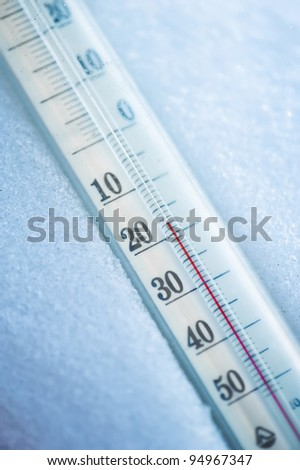 Thermometer in the snow at twenty degrees celsius