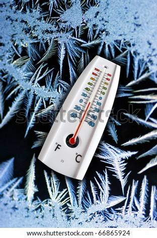 Thermometer indicating freezing temperatures in winter. - stock photo