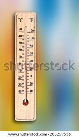Thermometer on abstract background