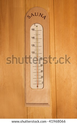 thermometer on wooden wall in sauna. - stock photo