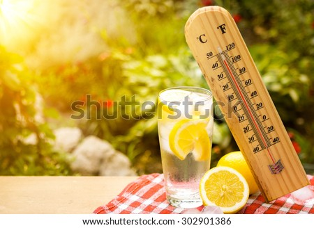 thermometer shows a high temperature during heat wave - stock photo