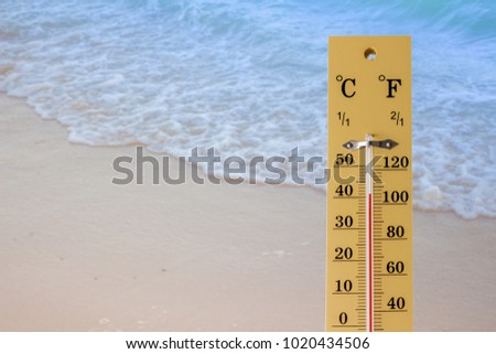 Thermometer shows high temperature in summer