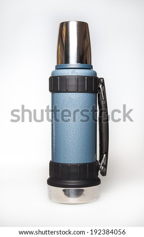 Thermos flask shot on a white background - stock photo