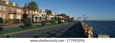 These are historic houses on Battery Street . They are next to the waterfront. They show the Southern living style in morning light.  - stock photo