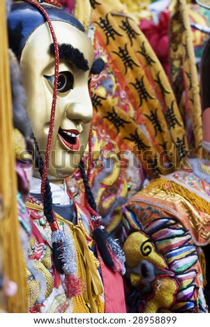 These are man-size puppets or costumes worn by temple workers during parades.  They are popular in Taiwan. They form a core part of Chinese Culture. - stock photo