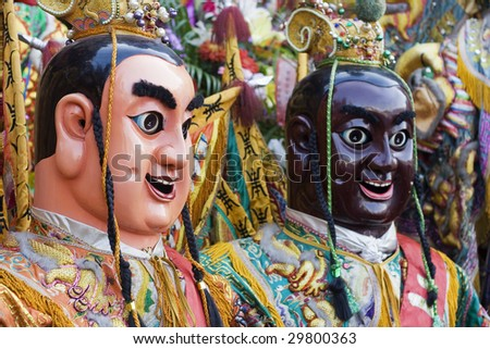 These are man-size puppets or costumes worn by temple workers during parades.   They form a core part of Chinese Culture.